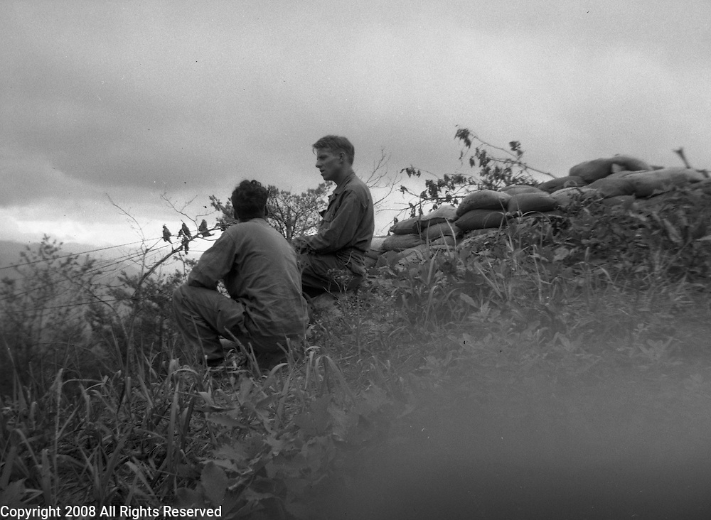 Two soldiers of the Second Infantry Division, U.S. Army, keep a watch for the Chinese during the Korean War. These are photos of the 2nd Infantry Division in the Korean War in 1950 or 1951.