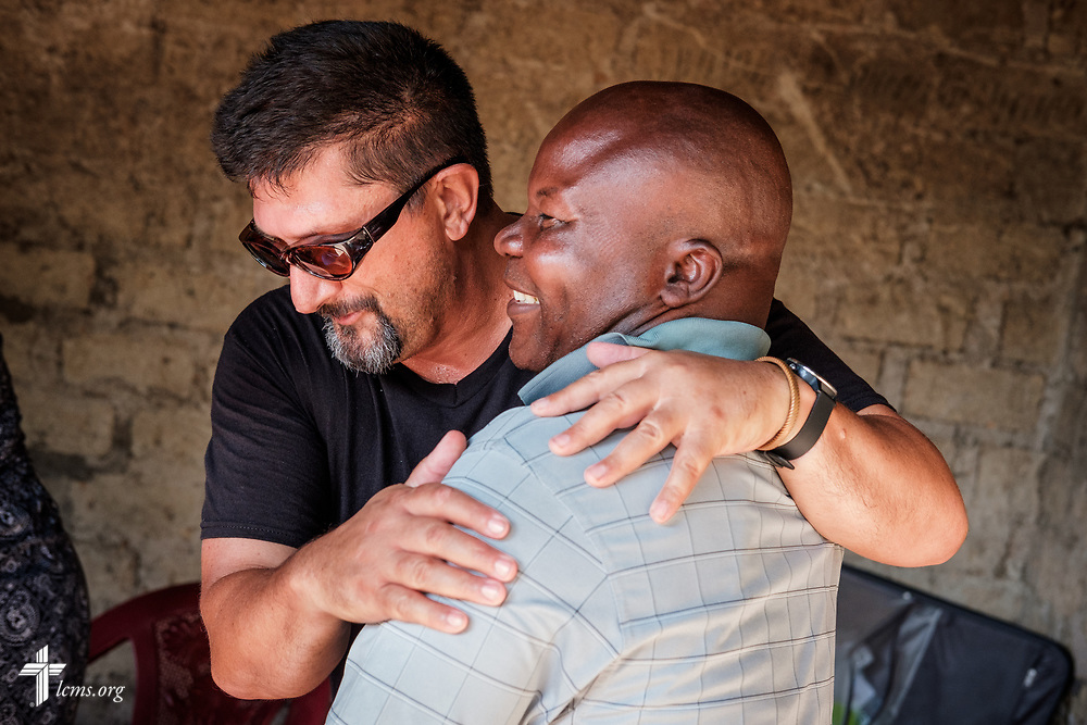 The Rev. Doug Thompson, career missionary to Sierra Leone, hugs the Rev. John Bundor, president of the Christ Evangelical Lutheran Church—Sierra Leone (CELC—SL), as the two meet again on the first day of the LCMS Mercy Medical Team on Monday, May 7, 2018, in the Yardu village outside Koidu, Sierra Leone, West Africa. LCMS Communications/Erik M. Lunsford