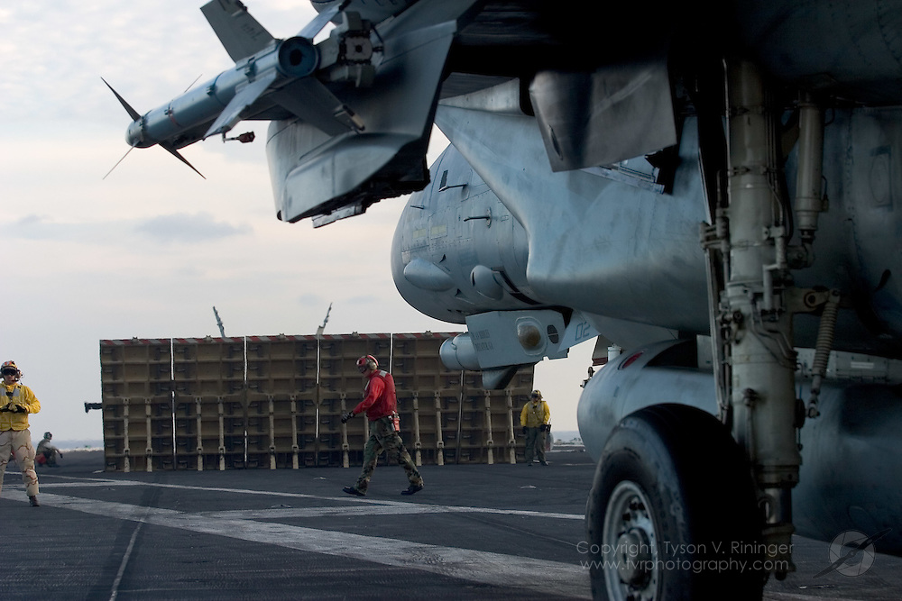 AJ102, an F-14 Tomcat from VF-31 'Tomcatters', taxis toward catapult number one on the deck of the USS Theodore Roosevelt CVN-71 during sea trials prior to their 2005 Mediterranean deployment. This would be the final cruise for the F-14 Tomcat and the last time it would ever see combat..