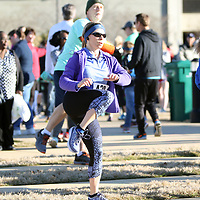 Bonnie Mask joins in the warm up exercise Saturday before the Run for Your Buns 5k at Fairpark