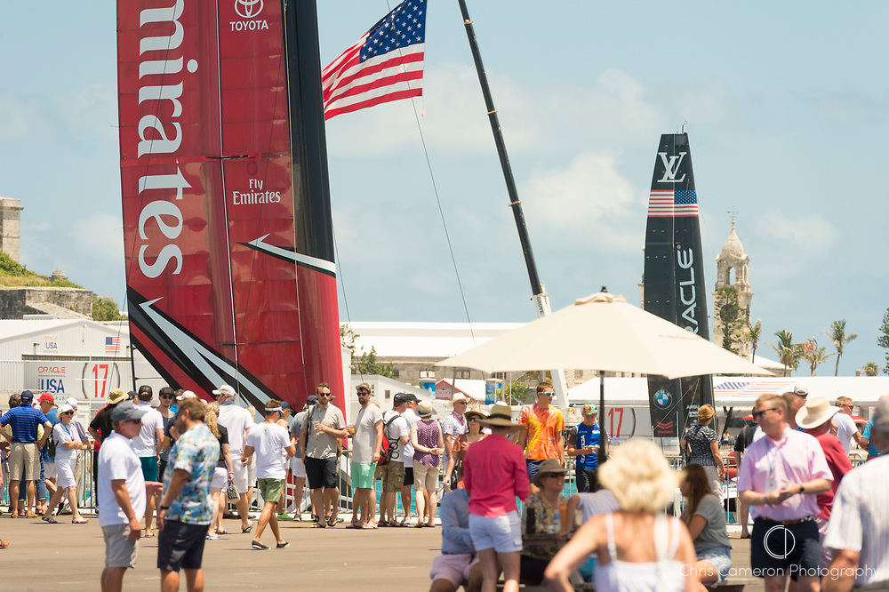 The America's Cup Village, Ireland Island, Bermuda, 18th June. Emirates Team New Zealand and Oracle Team USA AC50s wait at the dock before racing on day two of the America's Cup.