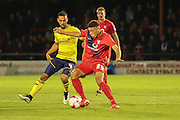 York City midfielder Ben Godfrey shiels the ball from Oxford United midfielder Kemar Roofe  during the Sky Bet League 2 match between York City and Oxford United at Bootham Crescent, York, England on 29 September 2015. Photo by Simon Davies.