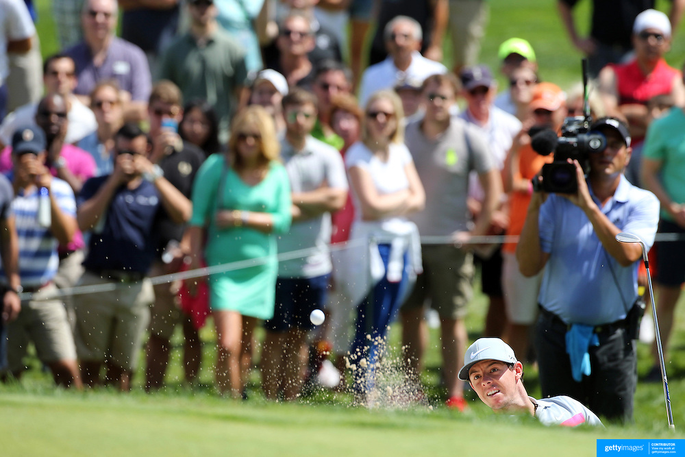 Rory McIlroy chips out of the sand trap on the fifth hole during the fourth round of theThe Barclays Golf Tournament at The Ridgewood Country Club, Paramus, New Jersey, USA. 24th August 2014. Photo Tim Clayton