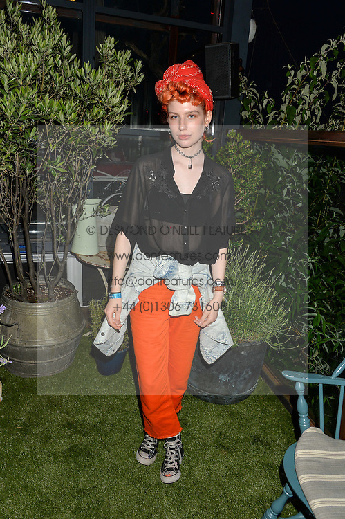 Fashion blogger CHARLIE BARKER at the Warner Music Group & GQ Summer Drinks hosted in asociation with Quintessentially at Shoreditch House, Ebor Street, London on 6th July 2016.