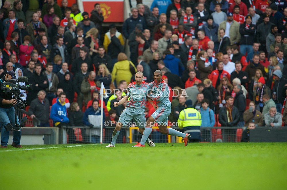 MANCHESTER, ENGLAND - Saturday, March 14, 2009: Liverpool's Andrea Dossena celebrates scoring his side's fourth goal against Manchester United with team-mate Ryan Babel during the Premiership match at Old Trafford. (Photo by David Rawcliffe/Propaganda)