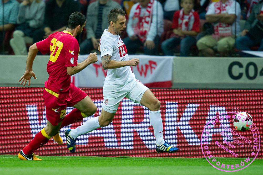 Poland's Jakub Wawrzyniak fights for the ball during the 2014 World Cup Qualifying Group H football match between Poland and Montenegro at National Stadium in Warsaw on September 06, 2013.<br /> <br /> Poland, Warsaw, September 06, 2013<br /> <br /> Picture also available in RAW (NEF) or TIFF format on special request.<br /> <br /> For editorial use only. Any commercial or promotional use requires permission.<br /> <br /> Mandatory credit:<br /> Photo by &copy; Adam Nurkiewicz / Mediasport