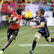 Henry Kayange straightarms a Scot enroute to a first half try in Kenya's17-14 victory over Scotland. Photo by Barry Markowitz, 2/10/12