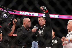 East Rutherford, NJ - May 05, 2012: Nate Diaz (Grey and white trunks) talks to Joe Rogan during UFC on FOX 3 at the Izod Center in East Rutherford, New Jersey.