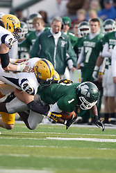 12 November 2011:  Cameron Allen is tackled in mid flight by Mike McLean during an NCAA division 3 football game between the Augustana Vikings and the Illinois Wesleyan Titans in Tucci Stadium on Wilder Field, Bloomington IL