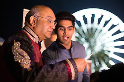 """© Licensed to London News Pictures. 01/11/2015. Leicester, UK. More than 35,000 people were estimated to have attended the annual Diwali ight switch-on which took place along the named """"Golden Mile"""" in Belgrave Road, Leicester. Pictured, Leicester MP Keith Vas, left,  welcomed Olympic boxer Vijender Singh who had stopped off on his way from Dheli to Ireland to be at the festival. Photo credit : Dave Warren/LNP"""