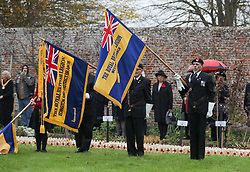 Members of the Royal British Legion lower their standards for the National Anthem during the official opening of the Field of Remembrance at Royal Wootton Bassett, in the grounds of Lydiard House and Park, Swindon.