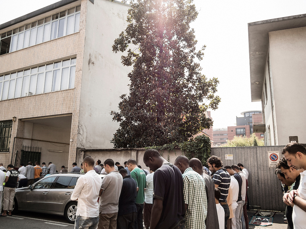 Ramadan on the road. Northern outskirts of Milan, Sesto San Giovanni. People praying. Milano 2012.