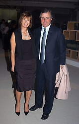 VISCOUNT & VISCOUNTESS ASTOR at an exhibition of work by Rolf Sachs - a unique world-renowned contemporary furniture designer, held in association with the Louisa Guinness Gallery and held at 250 Brompron Road, London on 6th October 2004.<br />