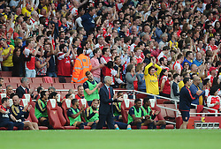 Arsenal Manager, Arsene Wenger and the Arsenal Bench applaud a goal  - Mandatory by-line: Joe Meredith/JMP - 25/07/2015 - SPORT - FOOTBALL - London,England - Emirates Stadium - Arsenal v Lyon - Emirates Cup