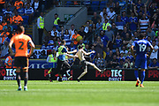 A pitch invader is apprehended by the stewards during the EFL Sky Bet Championship match between Cardiff City and Reading at the Cardiff City Stadium, Cardiff, Wales on 6 May 2018. Picture by Graham Hunt.
