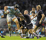 Twickenham, GREAT BRITAIN, Patricio ALBACETE, attacking the England line, tackled by Paul HODGSON and Shane GERAGHTY, during the Investic Challenge Series, England vs Argentina, Autumn International at Twickenham Stadium, Surrey on Sat 14.11.2009 [Photo, Peter Spurrier/Intersport-images]