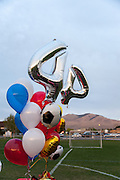 On May 2, 2014, balloons decorate the candlelight vigil of slain German exchange student, Diren Dede. Dede wore jersey #4 when playing soccer.
