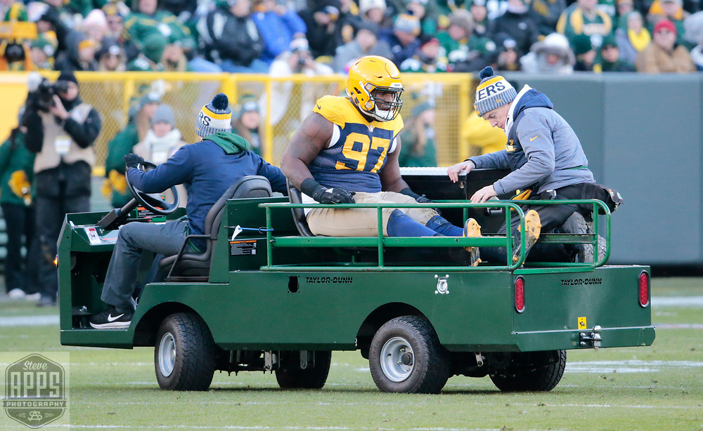 Green Bay Packers nose tackle Kenny Clark (97) is carted off the field in the 4th quarter. <br /> The Green Bay Packers hosted the Baltimore Ravens at Lambeau Field Sunday, Nov. 19, 2017. The Packers lost 23-0. STEVE APPS FOR THE STATE JOURNAL.