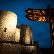Night shot of signs at Harlech Castle in Harlech, Gwynedd, on the northwest coast of Wales next to the Irish Sea. The castle was built by Edward I in the closing decades of the 13th century as one of several castles designed to consolidate his conquest of Wales.
