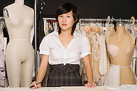 Portrait of female dressmaker at clothing store