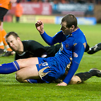Dundee United v St Johnstone.....27.01.10<br /> Kenny Deuchar slides in on Dusan Pernis which sparked a tussle between Dundee Utd players and saints players<br /> Picture by Graeme Hart.<br /> Copyright Perthshire Picture Agency<br /> Tel: 01738 623350  Mobile: 07990 594431