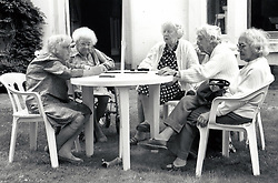 Group of elderly women playing dominoes, UK 1980s