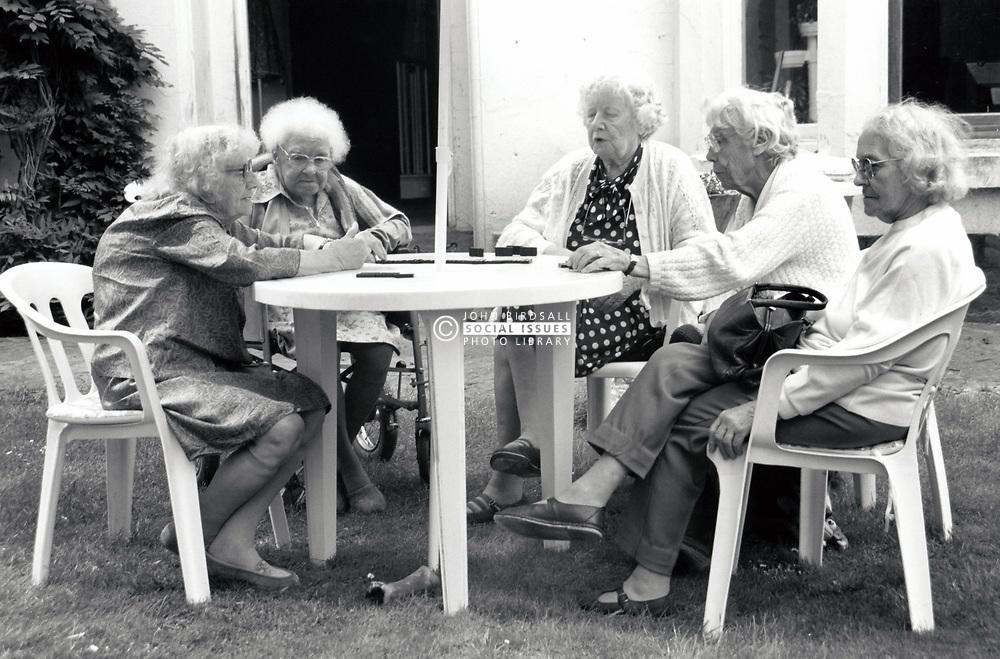 Group of elderly women playing dominoes, UK 1980s