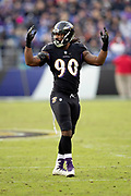 Baltimore Ravens outside linebacker Za'Darius Smith (90) waves his arms as he fires up the fans during the NFL week 11 regular season football game against the Cincinnati Bengals on Sunday, Nov. 18, 2018 in Baltimore. The Ravens won the game 24-21. (©Paul Anthony Spinelli)