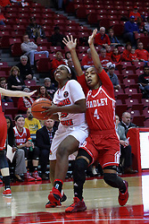 01 January 2017: Brechelle Beachum looks for the hoop defended by Alona Johnson during an NCAA Missouri Valley Conference Women's Basketball game between Illinois State University Redbirds the Braves of Bradley at Redbird Arena in Normal Illinois.