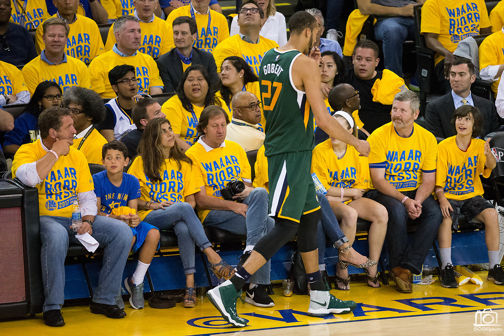 A Golden State Warriors fan gives Utah Jazz center Rudy Gobert (27) a dirty look as he leaves the game in the fourth quarter during Game 1 of the Western Conference Semifinals at Oracle Arena in Oakland, Calif., on May 2, 2017. (Stan Olszewski/Special to S.F. Examiner)