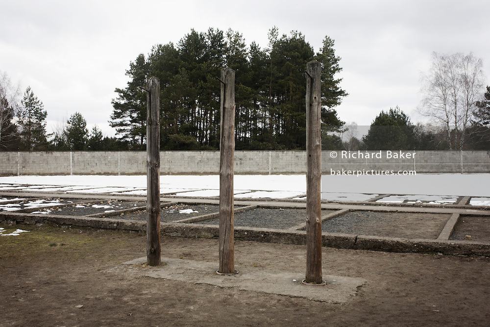 A winter landscape at the location of the special prison block in the Nazi and Soviet Sachsenhausen concentration camp during WW2, now known as the Sachsenhausen Memorial and Museum. Sachsenhausen was a Nazi concentration camp in Oranienburg, 35 kilometres (22 miles) north of Berlin, Germany, used primarily for political prisoners from 1936 to the end of the Third Reich in May 1945. After World War II, when Oranienburg was in the Soviet Occupation Zone, the structure was used as an NKVD special camp until 1950. Executions took place at Sachsenhausen, especially of Soviet prisoners of war. 30,000 inmates died there from exhaustion, disease, malnutrition, pneumonia, etc. The remaining buildings and grounds are now open to the public as a museum.