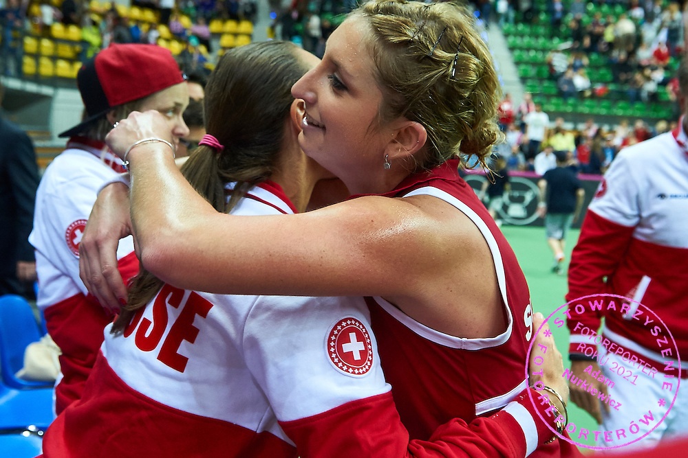 (R) Timea Bacsinszky from Switzerland celebrates after her victory with (L) Martina Hingis from Switzerland during the Fed Cup / World Group Play Off tennis match between Poland and Switzerland on April 18, 2015 in Zielona Gora, Poland<br /> Poland, Zielona Gora, April 18, 2015<br /> <br /> Picture also available in RAW (NEF) or TIFF format on special request.<br /> <br /> For editorial use only. Any commercial or promotional use requires permission.<br /> <br /> Adam Nurkiewicz declares that he has no rights to the image of people at the photographs of his authorship.<br /> <br /> Mandatory credit:<br /> Photo by &copy; Adam Nurkiewicz / Mediasport