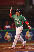 MEXICO CITY - MARCH 12: Shortstop Oscar Robles #26 of Mexico gets a high five after hitting a third inning home run against Cuba in Pool B, game 6 in the first round of the 2009 World Baseball Classic at Foro Sol Stadium in Mexico City, Mexico, on Thursday March 12, 2009. Cuba got a mercy rule win over Mexico by virtue of a 16-4 score in the seventh inning. (Photo by Paul Spinelli/WBCI/MLB Photos) *** Local Caption *** Oscar Robles
