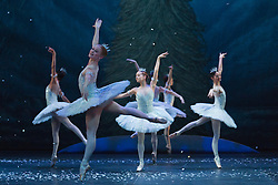 "© Licensed to London News Pictures. 10/12/2014. London, England. Dance of the Snowflakes performed by dancers from the English National Ballet. Dress rehearsal for the ballet ""The Nutcracker"" at the London Coliseum. Set to music by Pyotr Ilyich Tchaikovsky, the traditional Christmas ballet is choreographed by Wayne Eagling based on a concept by Toer von Schayk and Wayne Eagling. The English National Ballet Philharmonic orchestra accompanies dancers from the English National Ballet and Students from the English National Ballet School. Children performers are from the Tring Park School for the Performing Arts. The ballet runs at the London Coliseum from 11 December 2014 to 4 January 2015.  With Alina Cojocaru as Clara, Max Westwell as Nutcracker, Alejandro Virellles as Nephew, James Streeter as Mouse King and Fabian Reimair as Drosselmeyer. Photo credit: Bettina Strenske/LNP"