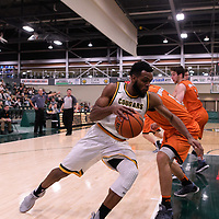 5th year forward Brian Ofori (11) of the Regina Cougars in action during the Men's Basketball Play-In game on February  8 at Centre for Kinesiology, Health and Sport. Credit: Arthur Ward/Arthur Images