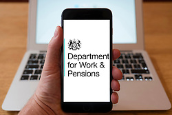 Using iPhone smartphone to display logo of the Department for Work and Pensions