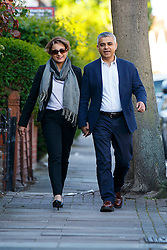 © Licensed to London News Pictures. 05/05/2016. London, UK. Labour's Mayor of London candidate SADIQ KHAN and his wife SAADIYA KHAN arrive at a polling station in south London on Thursday, 5 May 2016. Photo credit: Tolga Akmen/LNP
