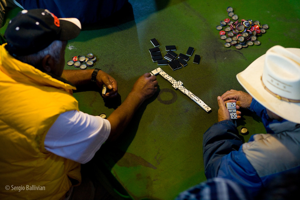 Mexican men playing dominoes in a pool hall in Santa Clara, Michocan, Mexico.