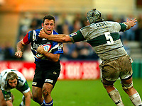 Photo:Scott Heavey/Back Page Images.<br /> Bath v London Irish. Zurich Premiership. 28/11/2004.<br /> <br /> Frikkie Welsh of Bath takes a high tackle from Bob Casey<br /> NORWAY ONLY