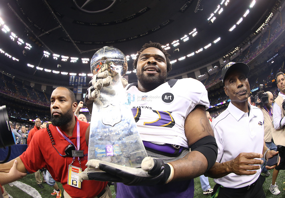 Bobbie Williams (63) of the Baltimore Ravens celebrates with the Vince Lombardi Trophy after defeating the San Francisco 49ers during the NFL Super Bowl XLVII football game in New Orleans on Feb. 3, 2013. The Ravens won the game, 34-31.  (Photo by Jed Jacobsohn)