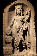 The Netherby Genius, a Roman relief sculpture of a genius or guardian spirit, found at Netherby, the site of Castra Exploratorum Roman Fort, before 1725, at the Tullie House Museum and Art Gallery, Carlisle, Cumbria, England. The figure is sacrificing over an altar with a sacrificial vessel in his right hand, and cornucopia or horn of plenty in his left. He is wearing a crown decorated with walls and turrets and is sculpted in an arched niche. Carlisle sits at the Western end of Hadrian's Wall. Hadrian's Wall was built 73 miles across Britannia, now England, 122-128 AD, under the reign of Emperor Hadrian, ruled 117-138, to mark the Northern extent of the Roman Empire and guard against barbarian attacks from the Picts to the North. The wall was fortified with milecastles with 2 turrets in between, and a fort about every 5 Roman miles. Picture by Manuel Cohen