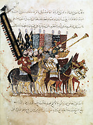 Troop of horsemen with banners, trumpets and drums, at religious ceremony. 1237 manuscript of Maqamat ('Assemblies') of al-Hariri. Bibliotheque Nationale, Paris.