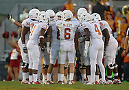 October 01, 2011: The Texas Longhorns offense huddles around Texas Longhorns quarterback Case McCoy (6) during the first half of the game between the Iowa State Cyclones and the Texas Longhorns at Jack Trice Stadium in Ames, Iowa on Saturday, October 1, 2011. Texas defeated Iowa State 37-14.