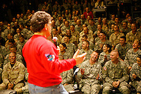 Al Franken performs at Tikrit, Iraq, during a USO tour.in december 2006..photograph by Owen Franken......... Al Franken Al Franken, USO tour