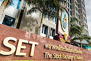 """24 AUGUST 2013 - BANGKOK, THAILAND:     The Stock Exchange of Thailand (SET) in Bangkok. The SET Index has fallen more than 3 percent since July on news weak GDP growth and lower than expected corporate profits. Thailand entered a """"technical"""" recession this month after the economy shrank by 0.3% in the second quarter of the year. The 0.3% contraction in gross domestic product between April and June followed a previous fall of 1.7% during the first quarter of 2013. The contraction is being blamed on a drop in demand for exports, a drop in domestic demand and a loss of consumer confidence. At the same time, the value of the Thai Baht against the US Dollar has dropped significantly, from a high of about 28Baht to $1 in April to 32THB to 1USD in August.  PHOTO BY JACK KURTZ"""