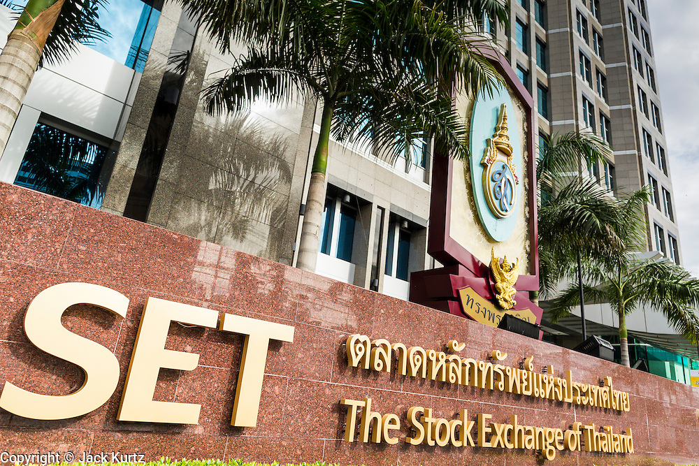 "24 AUGUST 2013 - BANGKOK, THAILAND:     The Stock Exchange of Thailand (SET) in Bangkok. The SET Index has fallen more than 3 percent since July on news weak GDP growth and lower than expected corporate profits. Thailand entered a ""technical"" recession this month after the economy shrank by 0.3% in the second quarter of the year. The 0.3% contraction in gross domestic product between April and June followed a previous fall of 1.7% during the first quarter of 2013. The contraction is being blamed on a drop in demand for exports, a drop in domestic demand and a loss of consumer confidence. At the same time, the value of the Thai Baht against the US Dollar has dropped significantly, from a high of about 28Baht to $1 in April to 32THB to 1USD in August.  PHOTO BY JACK KURTZ"
