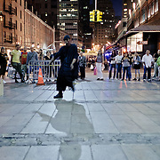 Dancer in the street near the Brooklyn Bridge