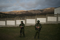 Unidentified soldiers awaits for results at the referendum day. An armed soldiers without identifying insignia keeps guard outside of a Ukrainian military base in the town of Perevevalne near the Crimean city of Simferopol. Simferopol, . Sunday, 16th March 2014. Picture by Daniel Leal-Olivas / i-Images