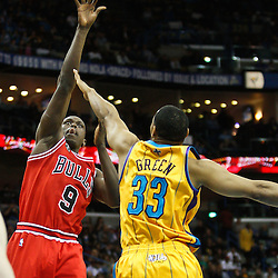 February 12, 2011; New Orleans, LA, USA; Chicago Bulls small forward Luol Deng (9) shoots over New Orleans Hornets shooting guard Willie Green (33) during the third quarter at the New Orleans Arena.  The Bulls defeated the Hornets 97-88. Mandatory Credit: Derick E. Hingle