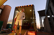 Equipment managers work in the Mal Moore Athletic Facility to get the University of Alabama football team ready for the trip to Baton Rouge to face LSU.  Equipment manager Jeff Springer watches from the ramp of the 18 wheeler for the last crates to be loaded and brought out.  Photo by Gary Cosby Jr.